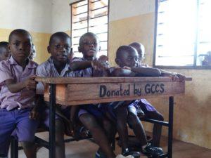 upendo_school_children_-_desks_funded_by_global