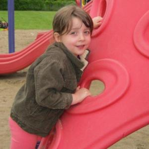 elizabeth_park-_girl_leaning_on_red_play_climber1499280388
